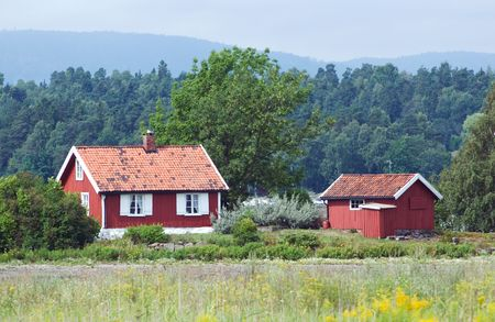 Small, old, red house in a rural area of Norway. Stock Photo - 4285801