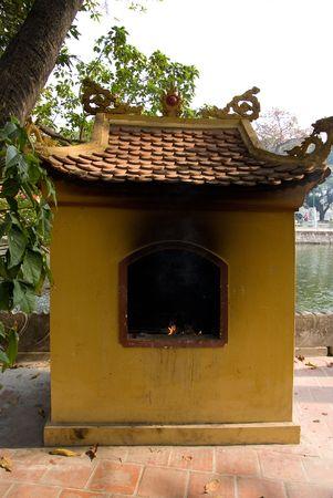 tran: Oven for burning ritual paper money at Tran Quoc Pagoda in Hanoi, Vietnam.