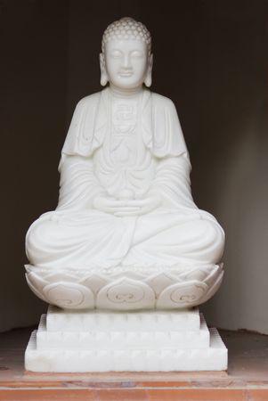 tran: White Buddha image at Tran Quoc Pagoda in Hanoi, Vietnam. Stock Photo