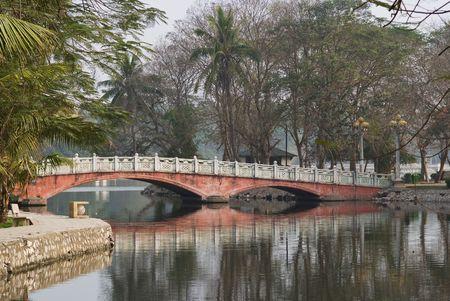 Bridge over the lake Ho Bay Mau in the Thong Nhat park in Hanoi, Vietnam. Stock Photo
