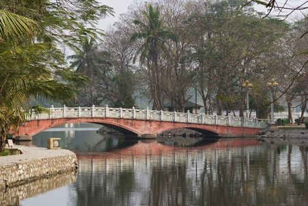 Bridge over the lake Ho Bay Mau in the Thong Nhat park in Hanoi, Vietnam. Stock Photo