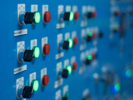 Electric switch panel with red and green light. Very shallow depth of field. Stock Photo