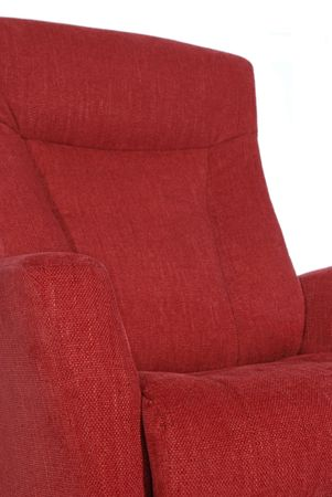recliner: Detail of red recliner on white background. Shallow depth of field, with only the nearest parts of the chair in focus.