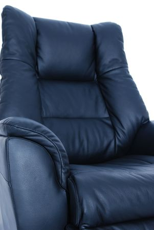 recliner: Detail of black leather recliner on white background. Shallow depth of field, with only the nearest parts of the chair in focus. Stock Photo