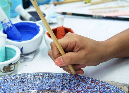 Painting of porcelain by hand. A traditional Thai pattern. photo