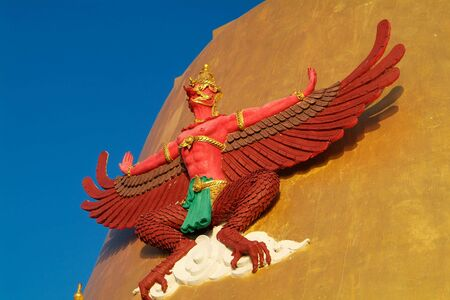 samut prakan: Garuda, the mythical bird, on a Golden Cheddi at a temple in the Samut Prakan province of Thailand.