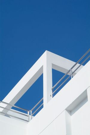 Detail of conteporary, functionalistic style villa. White concrete, stainless steel and aluminum. photo