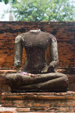 beheaded: Beheaded Buddha image at Wat Mahatat in Ayuttaya, Thailand. Shallow depth of field with only the Buddha image in focus. Stock Photo