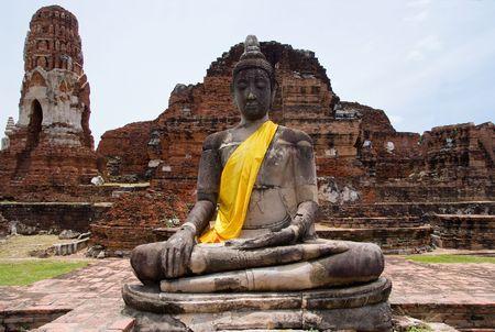 ayuttaya: Buddha image guarding the ancient ruins at Wat Mahatat in Ayuttaya, Thailand.  Stock Photo