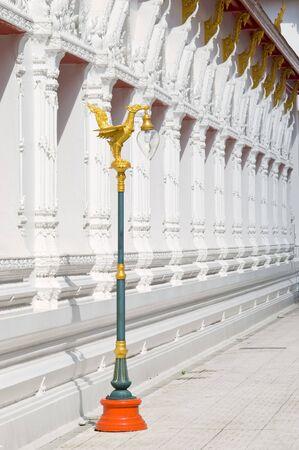 Lamp post and detail of temple building at Wat Mahatat in Bangkok, Thailand. photo