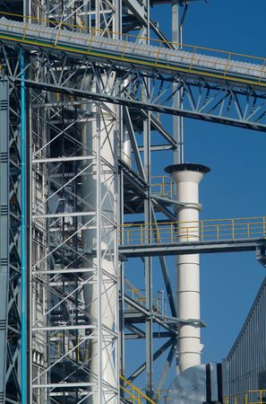 Detail of industrial processing plant with conveyor belt and smoke-stack. Stock Photo