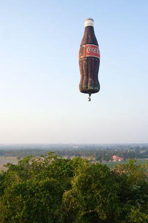12 13: PATTAYA, THAILAND - DECEMBER 12: Hot-air balloon shaped as a Coca-Cola bottle flying during Pattaya International Balloon Fiesta 2009 at Pattaya, Thailand on December 10-13, 2009.  Editorial