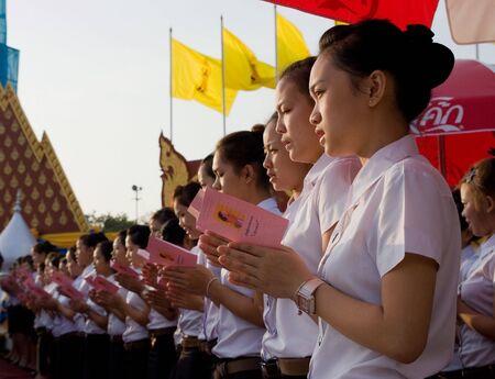 adulyadej: BANGKOK, THAILAND - DECEMBER 5: The celebration of the 82nd birthday of H.M. King Bhumipol Adulyadej in Bangkok, Thailand on December 5 2009. Student choir singing at Sanam Luang in Bangkok during sunrise.