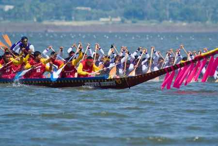 dragonboat: Pattaya, Thailand, Saturday 21 November 2009: The annual longboat races were arranged at the Maprachan Lake. The most spectacular class was the 55 man longboat, with teams from all over the nation. Shallow depth of field with the nearest boat in focus.