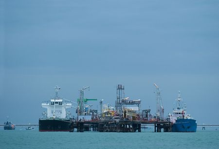 Two small oil tankers at an offshore oil terminal in the Gulf of Siam. photo