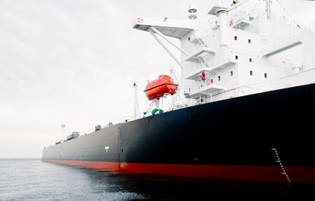 a big ship: 115,000 ton oil-tanker moored offshore.