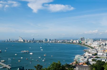 The city of Pattaya and Pattaya Bay in Thailand on a sunny day.