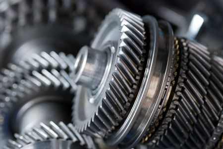 gearbox: Parts from a vehicle gearbox. Shallow depth of field with the nearest gear in focus. Stock Photo