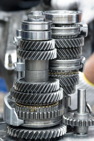 Assembly of a car gearbox. Shallow depth of field with the first group of gears in focus. Stock Photo
