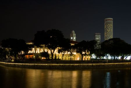 civilisations: Singapore at night with the classic architecture of the Asian Civilisations Museum in the foreground.