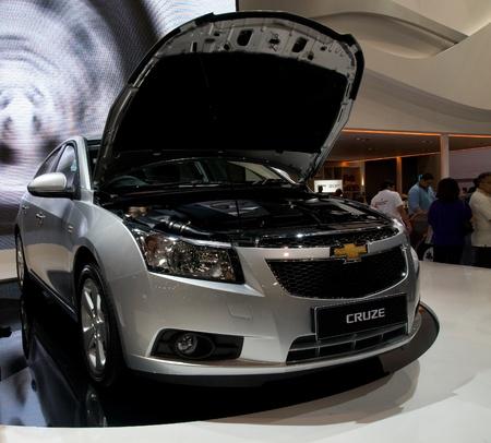 chevrolet: BANGKOK - DECEMBER 2: General Motors showing the new model Chevrolet Cruze at Motor Expo, Impact on December 2, 2010 in Bangkok, Thailand. Editorial