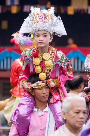 MAE HONG SON - APRIL 6: Young boy participating in the traditional Poy Sang Long Ceremony where young Shan boys are dressed like princes and paraded through the streets before entering monkhood on April 6, 2011 in Mae Hong Son, Thailand. Editorial