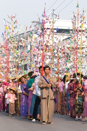 MAE HONG SON - APRIL 6: Participants at the parade of the traditional Poy Sang Long Ceremony where young Shan boys are dressed like princes and paraded through the streets before entering monkhood on April 6, 2011 in Mae Hong Son, Thailand. Stock Photo - 9256672