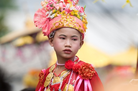 MAE HONG SON - APRIL 6: Young boy participating in the traditional Poy Sang Long Ceremony where young Shan boys are dressed like princes and paraded through the streets before entering monkhood on April 6, 2011 in Mae Hong Son, Thailand. Stock Photo - 9256658