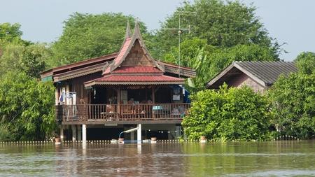 AYUTTAYA, THAILAND - OCTOBER 5: Traditional Thai house flooded during the monsoon season in Ayuttaya, Thailand on October 5, 2011.
