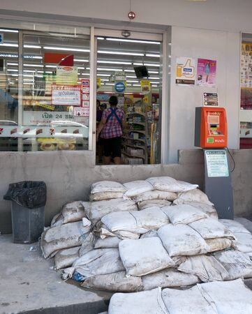 AYUTTAYA, THAILAND - OCTOBER 5: Convenience store protected against flooding during the monsoon season in Ayuttaya, Thailand on October 5, 2011. Stock Photo - 10781229