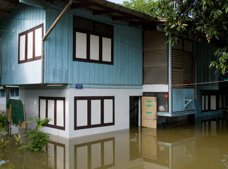 AYUTTAYA, THAILAND - OCTOBER 5: Flooded school building during the monsoon season in Ayuttaya, Thailand on October 5, 2011. Stock Photo - 10781223