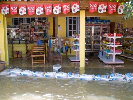 ayuttaya: AYUTTAYA, THAILAND - OCTOBER 5: Local shop flooded during the monsoon season in Ayuttaya, Thailand on October 5, 2011.