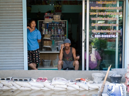 AYUTTAYA, THAILAND - OCTOBER 5: Shop owner building flood barricade from bricks to protect his shop during the monsoon season in Ayuttaya, Thailand on October 5, 2011. Stock Photo - 10781227