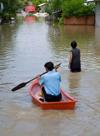 AYUTTAYA, THAILAND - OCTOBER 5: Flooded street during the monsoon season in Ayuttaya, Thailand on October 5, 2011. Stock Photo - 10781224