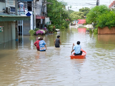 ayuttaya: AYUTTAYA, THAILAND - OCTOBER 5: Flooded street during the monsoon season in Ayuttaya, Thailand on October 5, 2011.