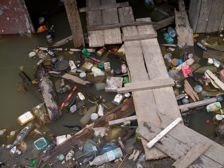 AYUTTAYA, THAILAND - OCTOBER 5: Garbage piling up at a flooded street during the monsoon season in Ayuttaya, Thailand on October 5, 2011. Stock Photo - 10781239