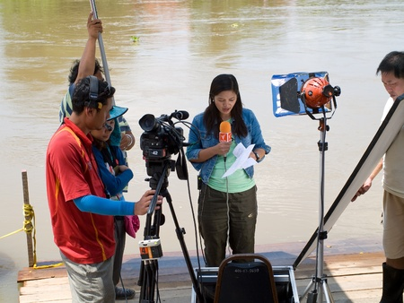 AYUTTAYA, THAILAND - OCTOBER 5: TV-team making a reportage about the flood situation during the monsoon season in Ayuttaya, Thailand on October 5, 2011. Stock Photo - 10781225