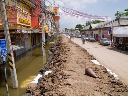 ayuttaya: AYUTTAYA, THAILAND - OCTOBER 5: City street with temporary mud barricade during the monsoon season in Ayuttaya, Thailand on October 5, 2011. Editorial