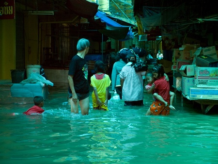 AYUTTAYA, THAILAND - OCTOBER 5: People at a flooded shopping mall during the monsoon season in Ayuttaya, Thailand on October 5, 2011. Stock Photo - 10781235