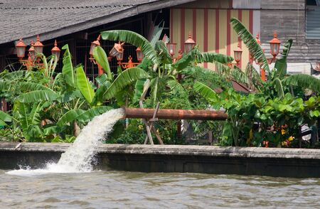 praya: Flood water being pumped from the streets of Bangkok into the Chao Praya river during the monsoon season.