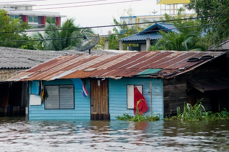 inundated: Flooded houses along a canal in Bangkok during the monsoon season.