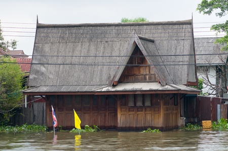 FLOODING: Flooded teak house along a canal in Bangkok during the monsoon season. Editorial