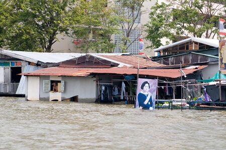chao praya: BANGKOK, THAILAND - OCTOBER 17: Flooded community along Chao Praya River during the worst flooding in decades in Bangkok, Thailand on October 17, 2011.