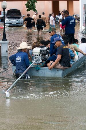 worst: BANGKOK, THAILAND - OCTOBER 29: The Royal Thai Navy helping people to get home during the worst flooding in decades in Bangkok, Thailand on October 29, 2011. Editorial