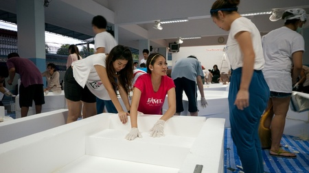 worst: BANGKOK, THAILAND - OCTOBER 29: Volunteers making simple boats of Styrofoam for transport of supplies to victims of the worst flooding in decades in Bangkok, Thailand on October 29, 2011. Editorial