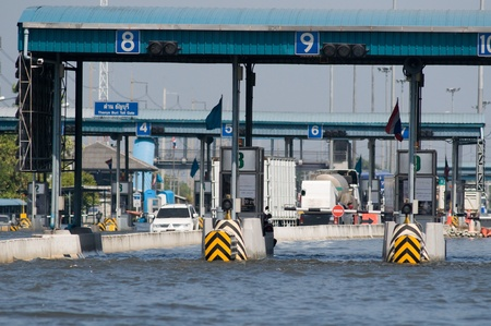 BANGKOK, THAILAND - NOVEMBER 1: Toll station at one of Bangkoks motorways during the worst flooding in decades in Bangkok, Thailand on November 1, 2011.
