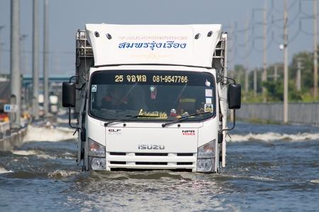 BANGKOK, THAILAND - NOVEMBER 1: Truck navigating one of Bangkoks motorways during the worst flooding in decades in Bangkok, Thailand on November 1, 2011.