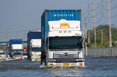 decades: BANGKOK, THAILAND - NOVEMBER 1: Trucks navigating one of Bangkoks motorways during the worst flooding in decades in Bangkok, Thailand on November 1, 2011.