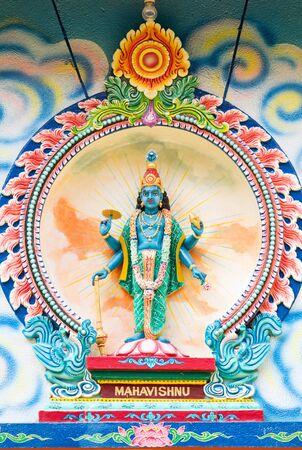 mariamman: Porcelain image of Mahavishnu, from Sri Mariamman Hindu temple in Ho Chi Minh City, Vietnam. Stock Photo