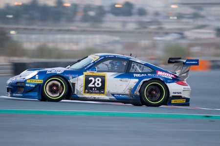 gt3: DUBAI - JANUARY 14: Car 28, a Porsche 997 GT3 R, in the morning during the 2012 Dunlop 24 Hour Race at Dubai Autodrome on January 14, 2012.
